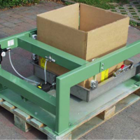 Use a compaction table to settle material in bins or boxes before shipping.