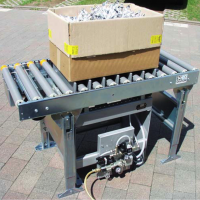 Compaction table used to settle plastic parts in a container.